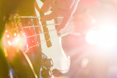 Man playing bass guitar in black and yellow Stock Photo