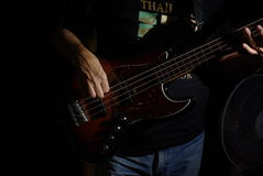 Man playing an bass guitar Royalty Free Stock Image