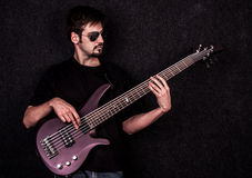 Man playing on bass guitar. Shot in studio Royalty Free Stock Image