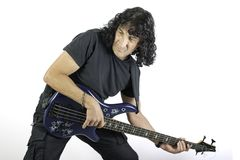 Man playing a bass guitar Stock Photography