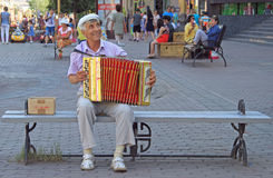 Man is playing bayan outdoor in Ulan Ude, Russia Royalty Free Stock Image