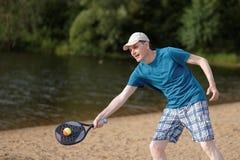 Man playing beach tennis Royalty Free Stock Image