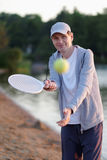 Man playing beach tennis Royalty Free Stock Images