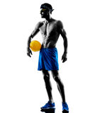 Man playing beach volley silhouette Stock Photos