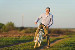 Man Playing with Bicycle Royalty Free Stock Images