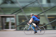 Man playing on bike for health. on May 9, 2015 in Marina bay,Singapore. Marina bay, Singapore - May 9: Man playing on bike for health. on May 9, 2015 in Marina Royalty Free Stock Photography