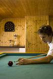 Man playing billiard. Table with ball and cue stick Stock Images