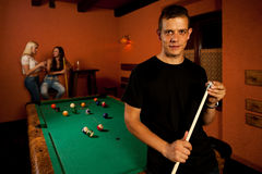 Man playing billiard in a bar Royalty Free Stock Photos