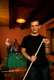 Man playing billiard in a bar Royalty Free Stock Photo