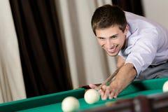 Man playing billiard at club. Young man playing billiard. Spending free time on gambling Royalty Free Stock Image
