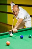Man playing billiards Royalty Free Stock Photos
