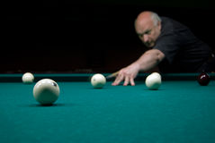 Man playing billiards Stock Image