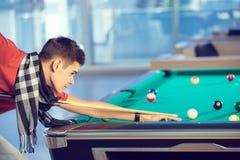 Man playing billiards in billiard club Stock Image
