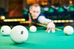 Man playing billiards in club. Billiards game. Russian pyramid. man playing billiard in club. Focus on ball Royalty Free Stock Images