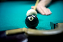 Man playing billiards. In dark club Stock Photo