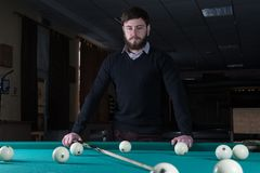 Man playing billiards. spend time playing billiards. royalty free stock photos