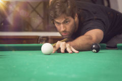 Man playing billiards in a pool table. Stock Photo