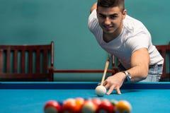 Man Playing Billiards Stock Image