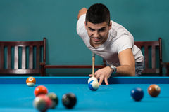 Man Playing Billiards Stock Photo