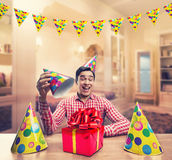 Man playing with Birthday hats Royalty Free Stock Photo