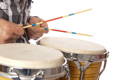 Man playing bongo with sticks Royalty Free Stock Photo