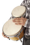 Man playing bongo under the arm Stock Photos