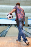 Man playing bowling. With football Royalty Free Stock Photo