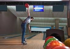 Man playing bowling. Young man playing bowling alone Royalty Free Stock Photos