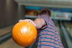 Man playing bowling. Young man playing bowling alone close up Stock Photo
