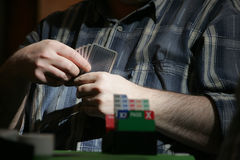 Man playing bridge Stock Images