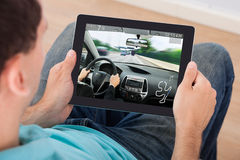 Man Playing Car Game On Digital Tablet Stock Photo