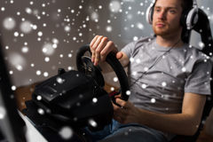 Man playing car racing video game at home Royalty Free Stock Images