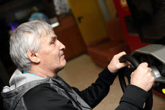 Man playing with car simulator Stock Images