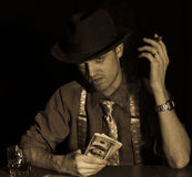 Man playing card game Stock Photo