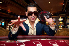 Man playing cards. Young man in trendy clothes  playing cards in casino Royalty Free Stock Image