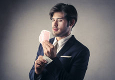 Man playing cards Stock Photography