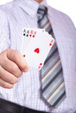 Man and playing cards in hand Royalty Free Stock Photo