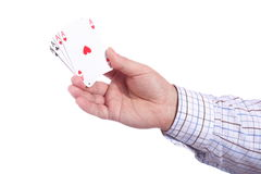 Man and playing cards in hand Stock Photo