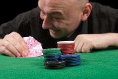 Man playing in casino poker Royalty Free Stock Photography