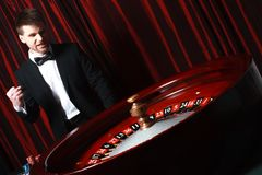 Man playing at the casino. Studio shot royalty free stock photos