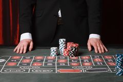 Man playing at the casino Stock Images