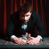 Man playing at the casino Stock Photography
