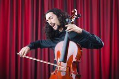 Man playing the cello Stock Images
