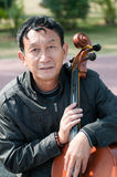 Man playing cello Stock Images