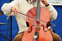 Man Playing Cello. Man Wearing Sweater Playing a Cello Stock Photo