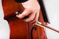Man playing on cello Stock Images