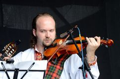 Man playing celtic medieval music in traditional scottish clothes Royalty Free Stock Photography