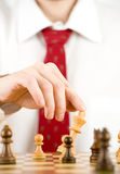 Man playing chess Stock Photo