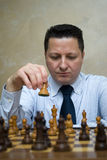 Man playing chess Stock Photography