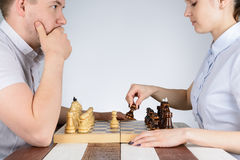 Man playing chess against girls Royalty Free Stock Photography